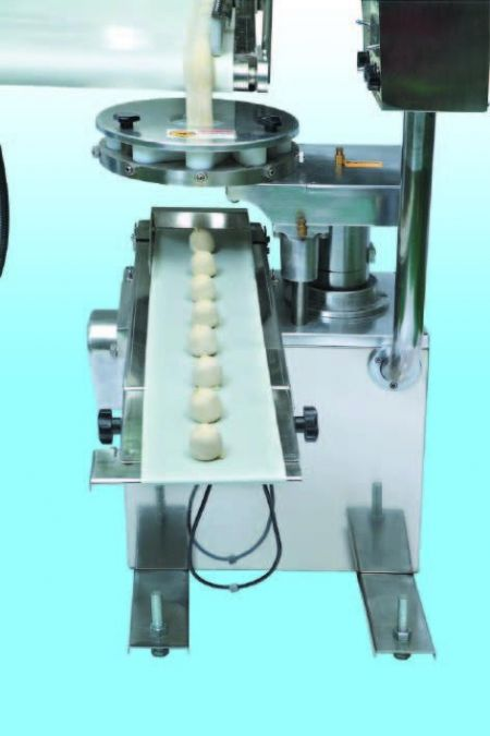 Automatic Layer & Stuffed Paratha Production Line - The plain or stuffed dough bar goes through the wrapping mechanism to be formed into dough balles. The both ends are closed to keep from the leak of stuffing and keep the layers.